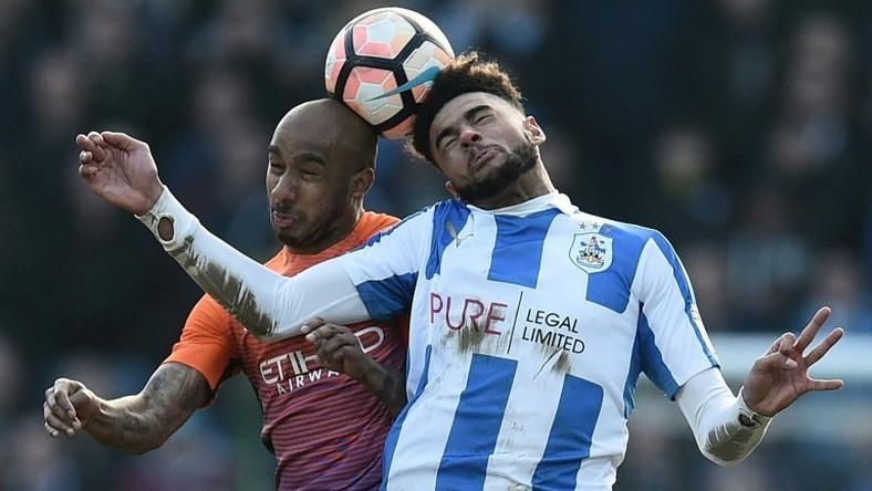 Huddersfield Town's Philip Billing (R) vies with Manchester City's Fabian Delph during their English FA Cup fifth round match on February 18, 2017