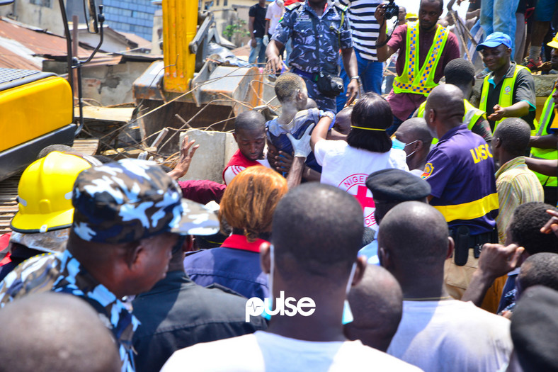 Most of the people that formed the crowd at the crash site wanted a glimpse of a boy that was rescued from ruins that also caused 10 persons to lose their lives.