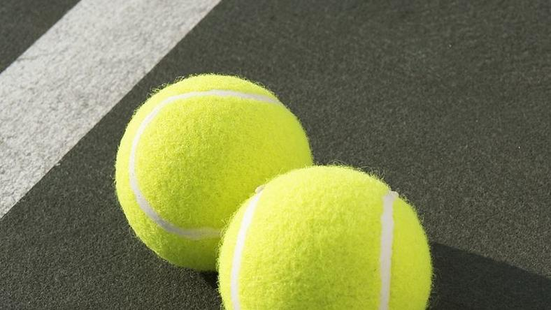 ___8940168___2018___10___5___9___two-tennis-balls-on-tennis-court-elevated-view-royalty-free-image-200443252-001-1538667208