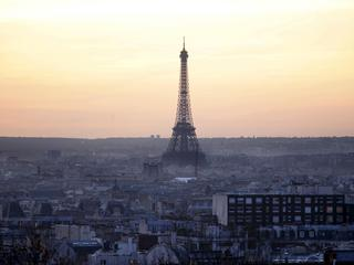 The Eiffel Tower is seen at sunset in Paris