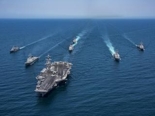 Korean and US destroyers carriers cruisers transit the western Pacific
