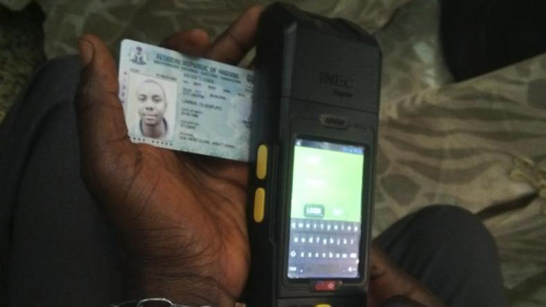 A Permanent Voter's Card being tested on a card reader meant for use in Nigeria's upcoming general elections.
