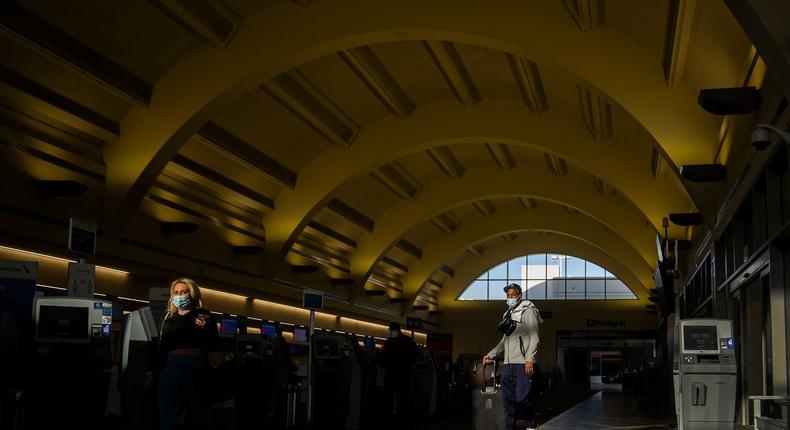 Masked travelers at John Wayne Airport in Santa Ana, California.