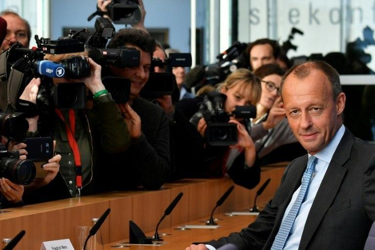 The other front-runner is former CDU parliamentary group leader Friedrich Merz, an old rival of Merkel