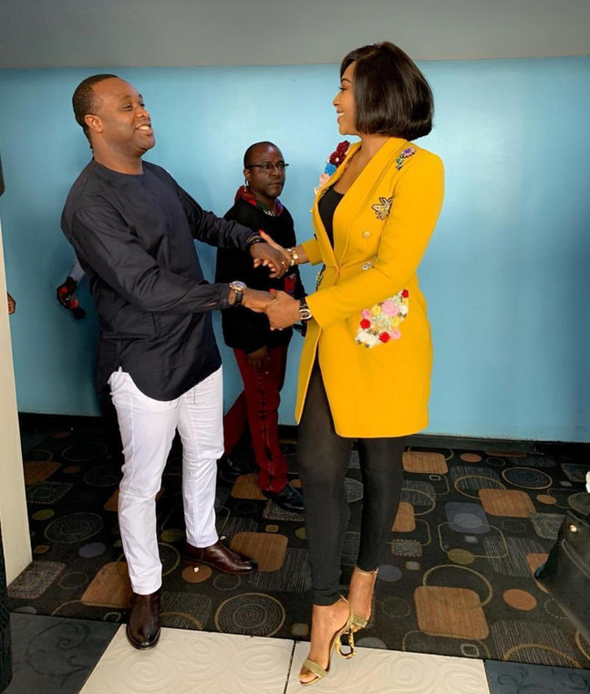 Femi Adebayo and Lilian Esoro exchange pleasantries at the premiere of 'Jumbled.' [Bami Greg]