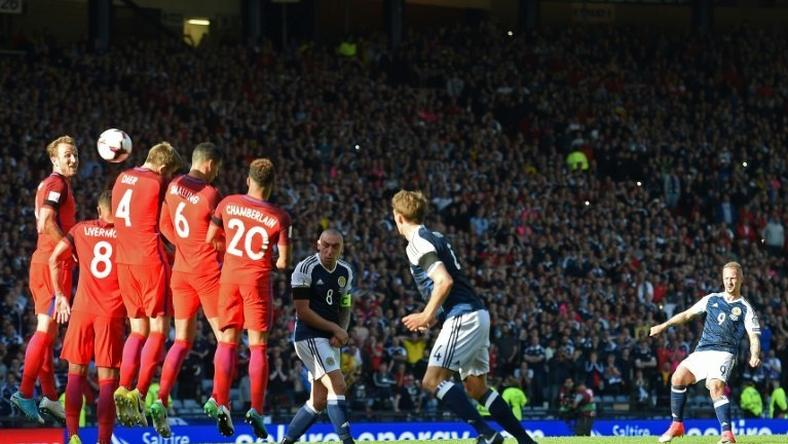 Scotland's striker Leigh Griffiths (R) hits a freekick over the England wall to score their second goal during the group F World Cup qualifying football match between Scotland and England at Hampden Park in Glasgow - the game ended 2-2