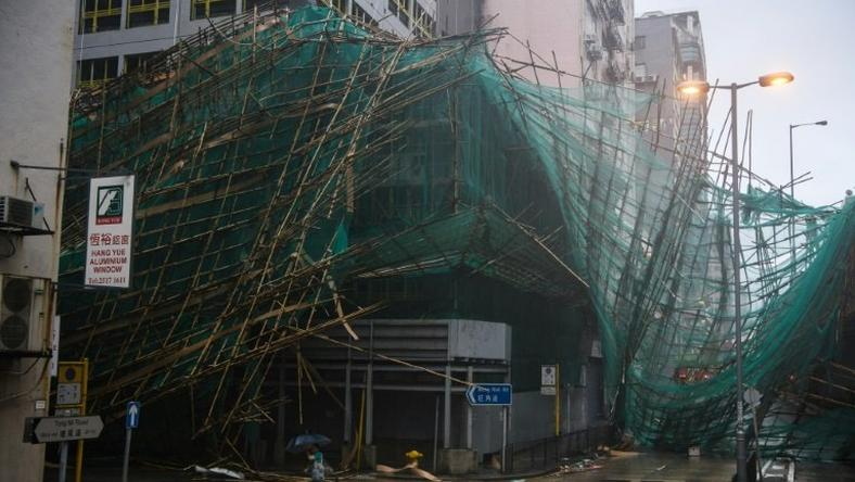 Hong Kong weather authorities issued their maximum alert for the storm, which hit the city with gusts of more than 230 kilometres per hour (142 mph) and left 213 people injured, according to government figures