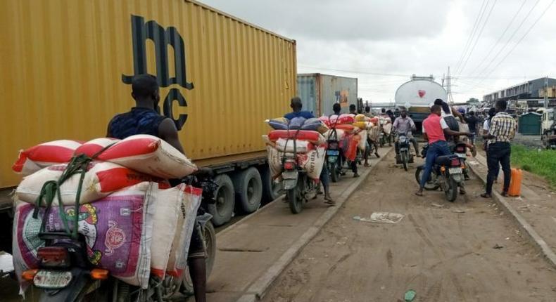 Okada riders smuggles rice from Seme Border on Lagos-Badagry Expressway. (Image credit: Business Highlights)