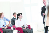 stock-photo-multi-ethnic-business-people-at-a-seminar-in-the-office-42566764
