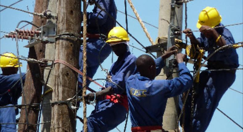 Kenya Power technicians fixing power lines