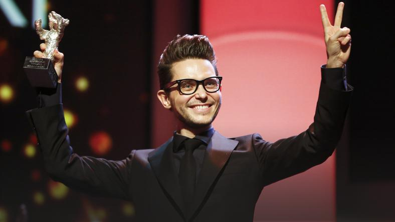 Wasilewski holds up the Silver Bear award for the best script for his film 'United States of Love' during the awards ceremony of the 66th Berlinale International Film Festival in Berlin