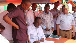 File image of former Tana River Governor Hussein Dado signing documents