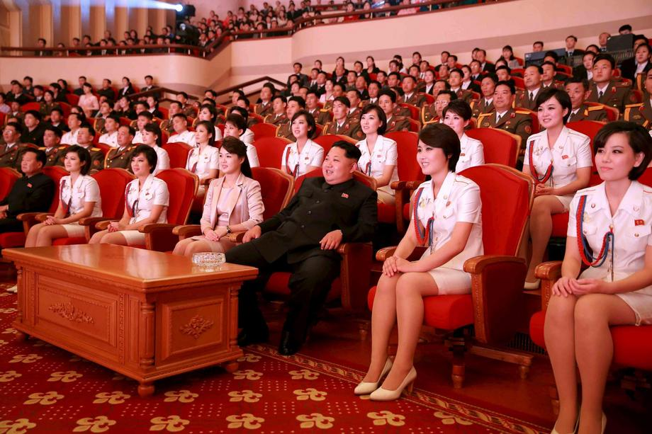 North Korean leader Kim Jong Un and wife Ri Sol Ju enjoy an art performance given by the Chongbong B