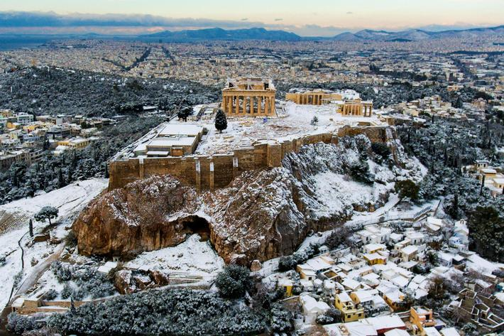The Parthenon temple atop the ancient Acropolis is seen following a rare snowfall in Athens