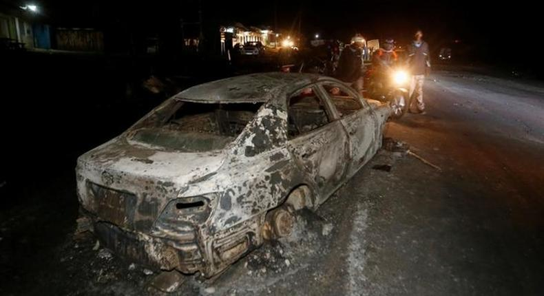 File image of a torched car during a past accident with an oil tanker