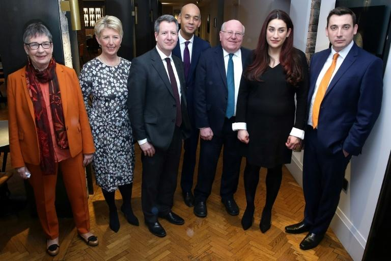 Former Labour Party MPs (from left) Ann Coffey, Angela Smith, Chris Leslie, Chuka Umunna, Mike Gapes, Luciana Berger and Gavin Shuker pose for a photograph.