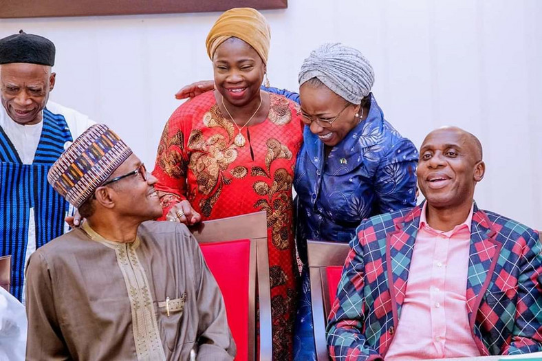 President Muhammadu Buhari, Transport Minister Rotimi Amaechi and Abike Dabiri-Erewa attend a function (Punch)