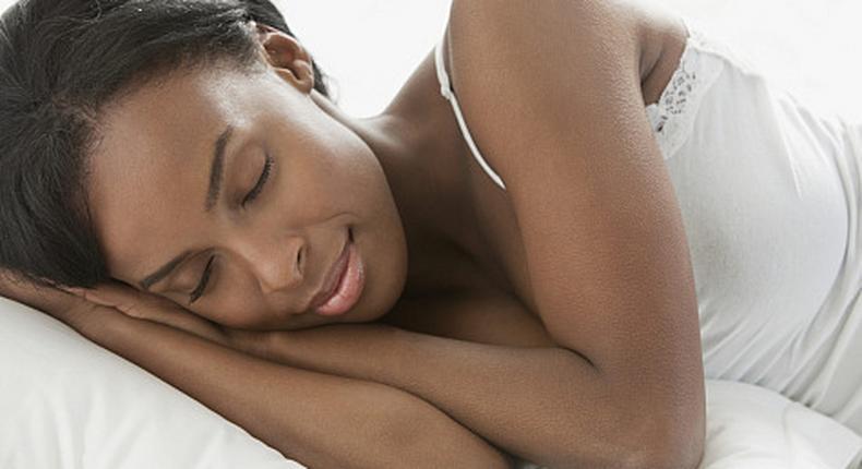 Woman sleeping(Natural Hair Mag)