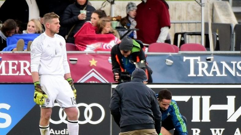 Jordan Morris of Seattle Sounders receives attention from staff in front of goaltender Zac MacMath of Colorado Rapids after an injury during his goal for a 1-0 lead at Dick's Sporting Goods Park on November 27, 2016