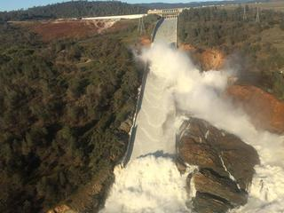 A damaged spillway with eroded hillside is seen in an aerial photo taken over the Oroville Dam in Or