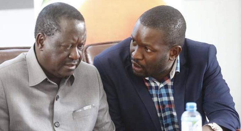 Raila Odinga with Edwin Sifuna