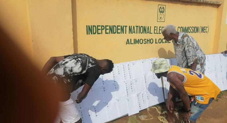 Voters checking their names and details at INEC Office in Alimosho Local Government on Friday in Lagos. (NAN).