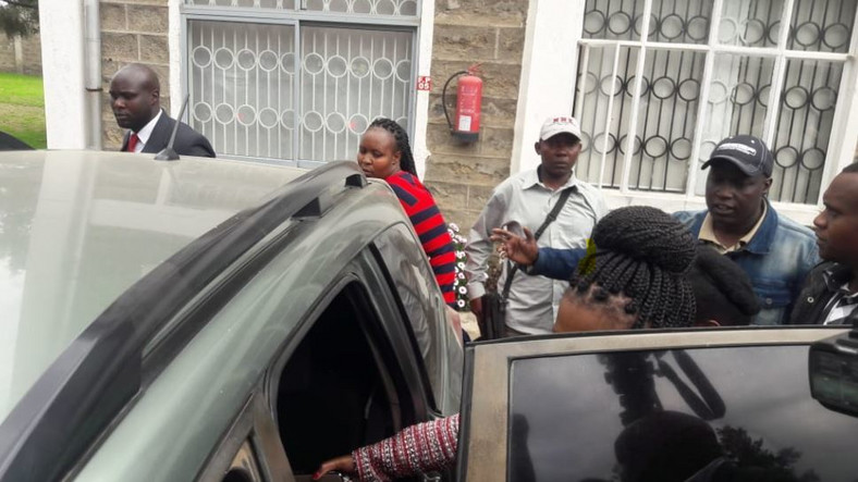 Keroche Breweries CEO Tabitha Karanja enters a police car