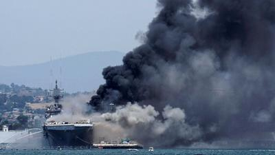 Photos capture the intense fight against the fire that has been burning aboard a US Navy warship for over 24 hours