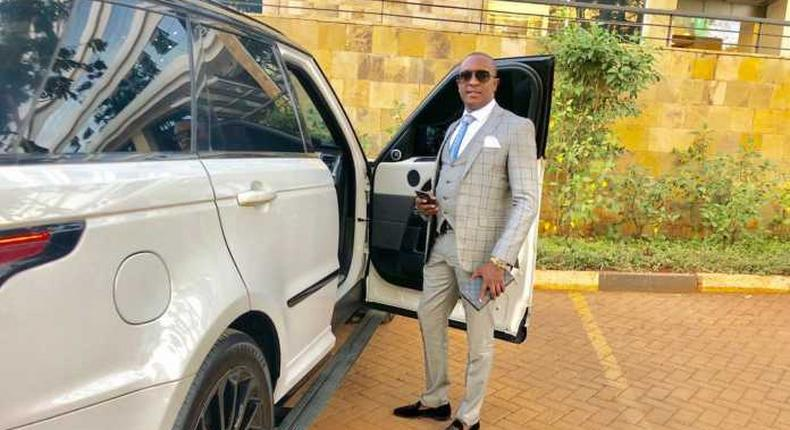File image of controversial politician Steve Mbogo standing next to one of the high-end vehicles in his fleet DCI has impounded one of his Range Rovers