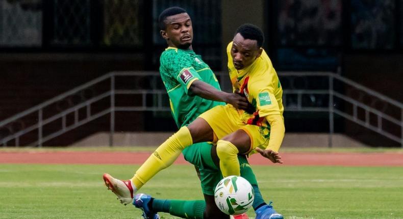 South Africa midfielder Teboho Mokoena (L) and Zimbabwe forward Khama Billiat (R) clash during a World Cup qualifier in Harare on Friday Creator: Jekesai NJIKIZANA