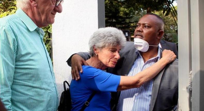 DCI George Kinoti consoles Dutch citizen Tob Cohen's Sister Gabrielle as her husband Roy Strathen looks on