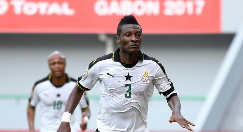 Ghana's forward Asamoah Gyan celebrates after scoring a goal during the 2017 Africa Cup of Nations group D football match against Mali in Port-Gentil on January 21, 2017