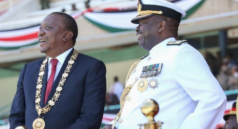 President Uhuru adorning his CGH medal with General Mwathethe during 2017 Jamhuri Day celebrations