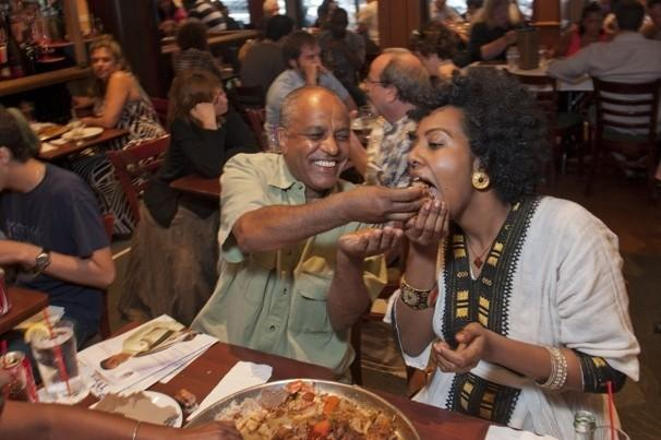 Ethiopians eating Injera, the country's staple food that doubles as cutlery.