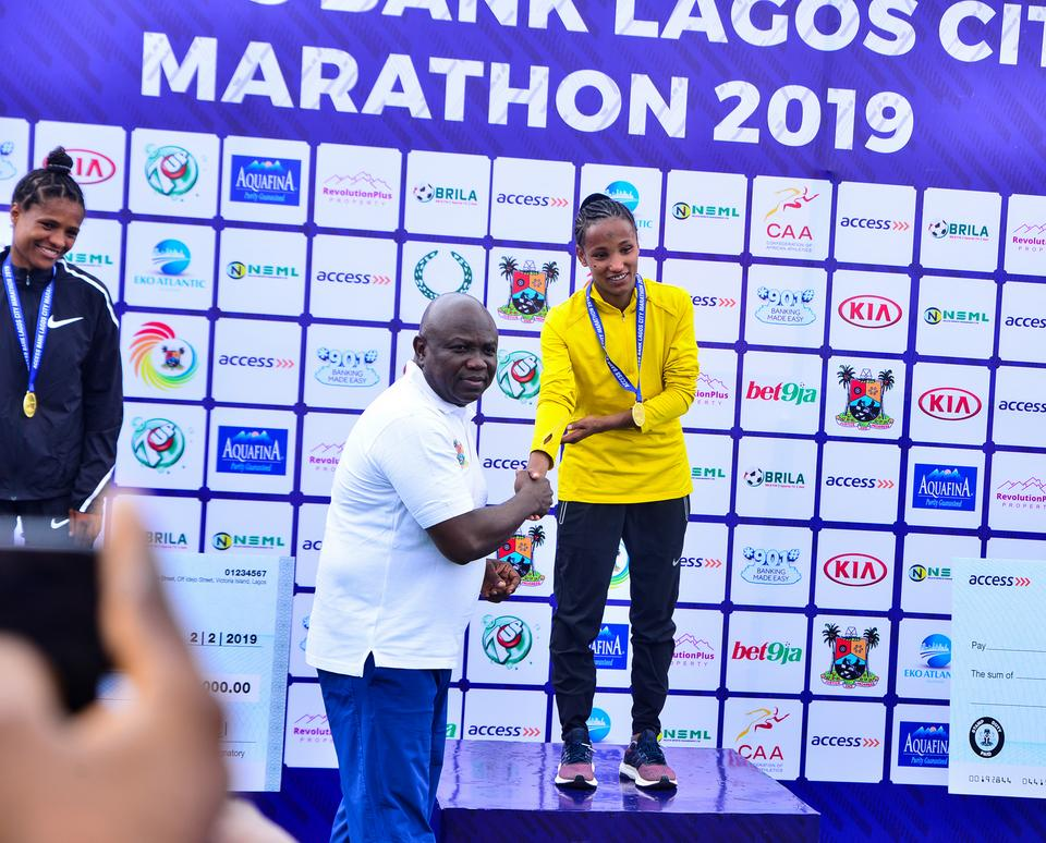 Governor Akinwumi Ambode with winner of the female 42km event, Ethiopian Dinke Meseret at Access Bank Lagos City Marathon 2019