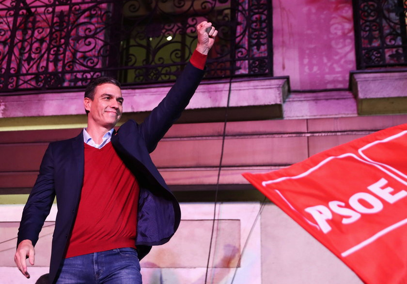 Spain's acting Prime Minister and Socialist Party leader (PSOE) candidate Pedro Sanchez reacts to su