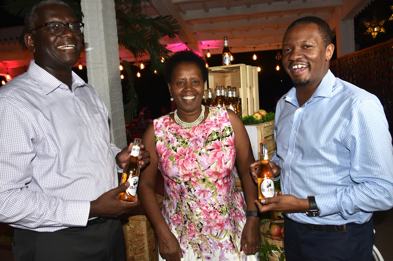 Kenya Breweries Limited Sales Director, Mr Andrew Kilonzo (left) and Corporate Relations Director, Mr Eric Kiniti share a light moment with Managing Director, Mrs Jane Karuku (centre) shortly after the unveil of Sikera Apple Cider.  Sikera is the newest innovation from Kenya Breweries Limited and the second alcoholic cider from the company.