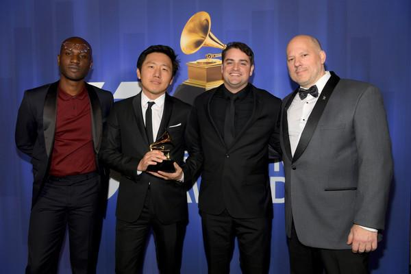 """Ibra Ake, HiroMurai  and Jason Cole pose with the award for best music video for Childish Gambino's """"This Is America"""" at the 61st annual Grammy Awards. (Photo by Chris Pizzello/Invision/AP)"""