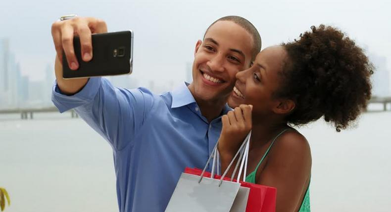 Couple taking a selfie (Courtesy)
