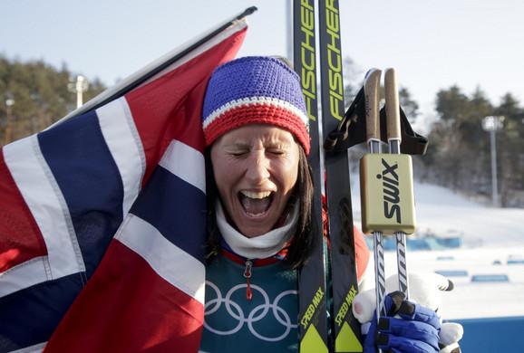 Marit Bjergen slavi zlato u kros kantriju