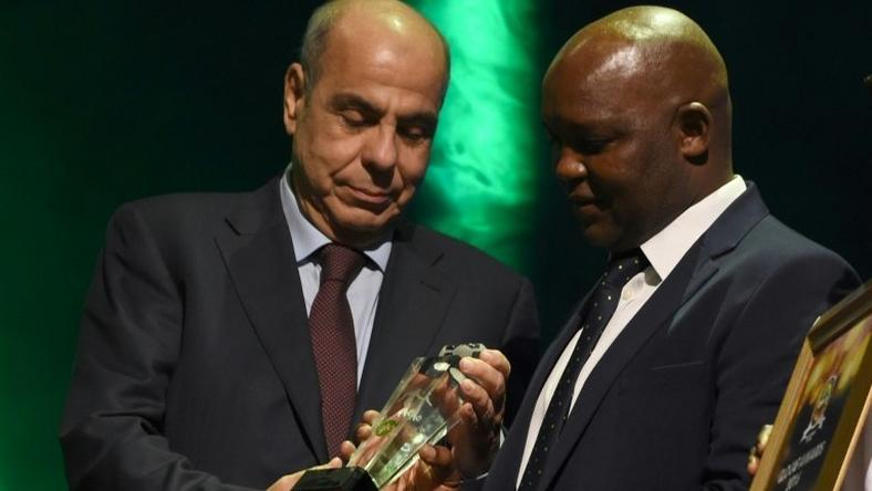 Pitso Mosimane (R), coach of Mamelodi Sundowns, seen here receiving an award during the African Footballer of the Year Awards in Abuja in January, 2017 said he was relieved after his team won a third Premiership title in five seasons