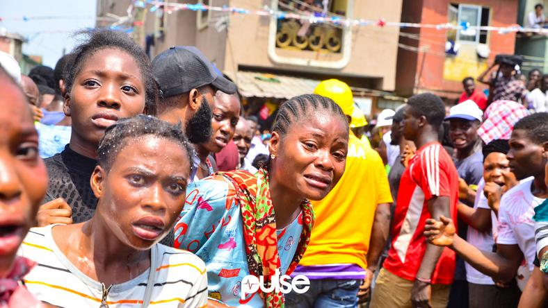 Residents watch with trepidation as rescue operations proceed at site of Lagos building collapse (Pulse)