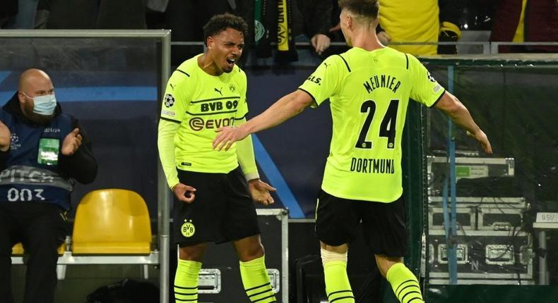 Dortmund's Dutch forward Donyell Malen (L) celebrates his first goal for the club Creator: Ina Fassbender