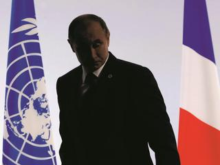 Russian President Putin leaves after delivering a speech for the opening day of the World Climate Ch