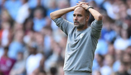 Pep Guardiola's Manchester City are three points behind the Premier League leaders Creator: Oli SCARFF