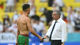 Portugal coach Fernando Santos consoles Cristiano Ronaldo after the defeat in Munich Creator: PHILIPP GUELLAND