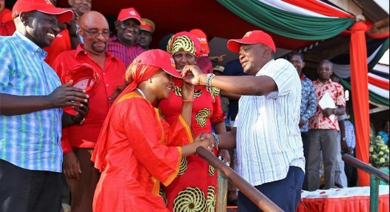 File image of President Uhuru Kenyatta and DP Ruto receiving Joyce Lay to the Jubilee party in 2017