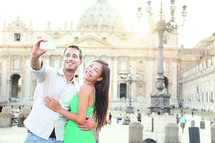 stock-photo-tourists-couple-by-vatican-city-and-st-peter-s-basilica-church-in-rome-happy-travel-woman-and-man-186348980