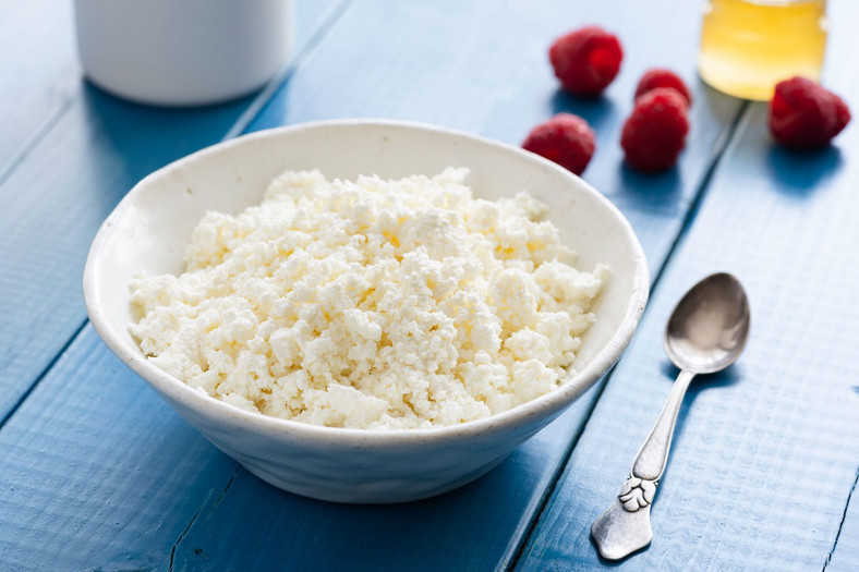Fresh cottage cheese or ricotta or tvorog in a bowl