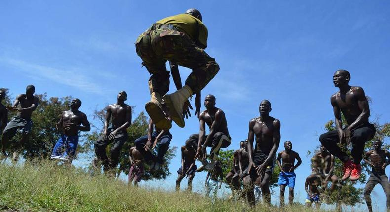 A KDF official takes recruits through a drill during tryouts